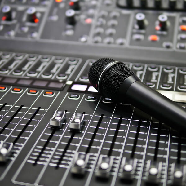 microphone laying on a audio board